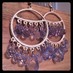 Handcrafted dangle earrings with blue bead accents